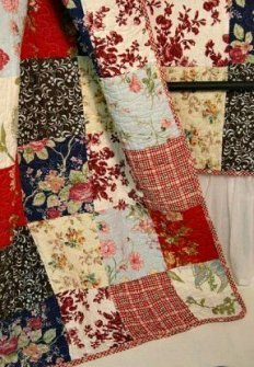 Patchwork quilt in reds and cream