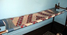 Amish quilt on quilt frame