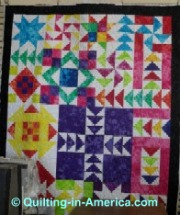 Vivid colors in star and flying geese quilt