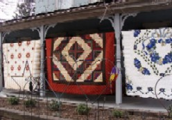 Amish quilts on a porch