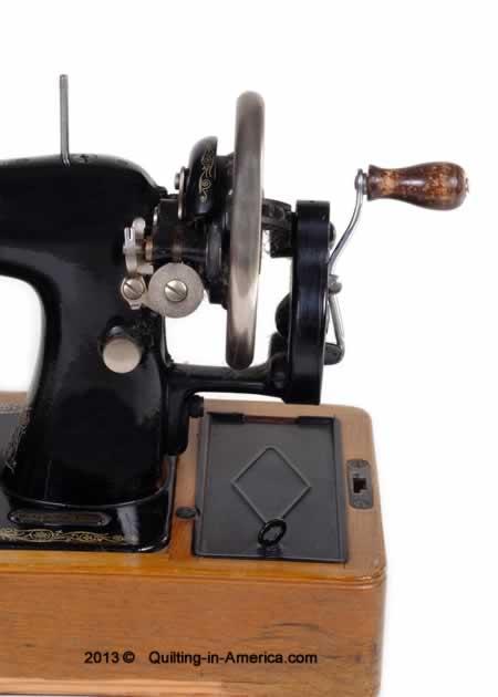 Antique hand-crank sewing machine