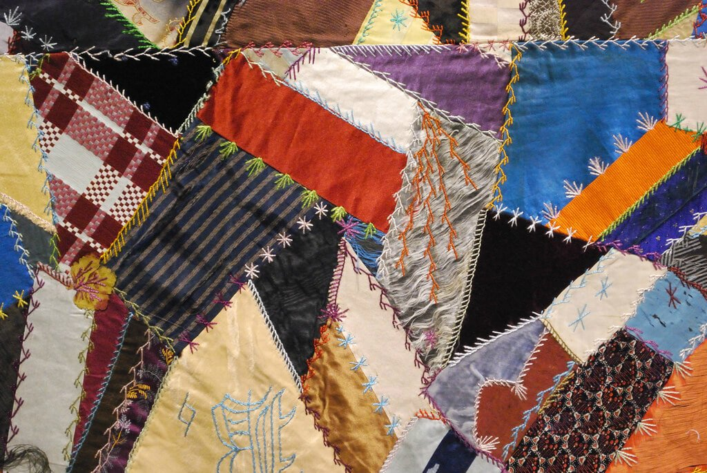 Crazy quilt with intricate stitching.
